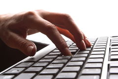 Fingers on keyboard. Fingers on the keyboard, pressing a key Royalty Free Stock Images