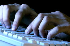 Fingers on  the keyboard. Fingers on the keyboard, pressing a key Royalty Free Stock Photos