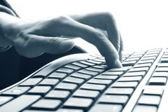 Fingers on keyboard. Fingers on the keyboard, pressing a key Royalty Free Stock Photo