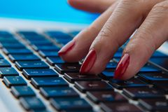 Fingers on keyboard Stock Images