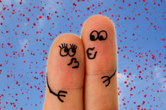 Fingers kissing with faces Royalty Free Stock Photo