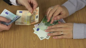 Fingers knocking on table and grab euro banknotes for man hand stock footage