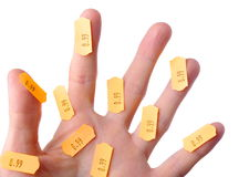 Fingers with label on white Royalty Free Stock Images