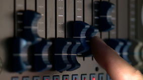 Fingers on the lighting control console to the TV studio. Vertical, close-up stock video