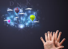 Fingers looking at hot air balloons. Happy cheerful smiley fingers looking at hot air balloons in the cloudy sky Royalty Free Stock Photography