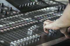 Fingers move the sliders on the big sound mixer 3 royalty free stock photos