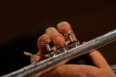 Fingers musician plays the trumpet closeup Stock Images