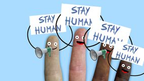 Fingers of one hand, of various ethnic groups manifest with stay human and megaphones banners, ideal footage to stock photo