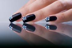 Fingers with original design manicure Stock Photos