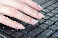 Fingers over the keyboard Stock Photos
