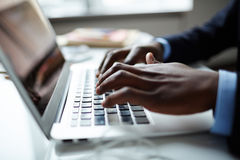Fingers over keypad. Fingers of businessman over laptop keypad Royalty Free Stock Images