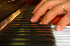 Fingers on piano. Hands playing the piano Royalty Free Stock Photos