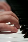 Fingers on the piano keyboard Stock Photos
