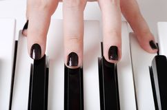Fingers on piano keys Royalty Free Stock Image