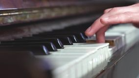 Fingers on the piano. Playing the piano fingers mens stock video footage
