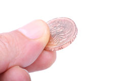 Fingers picking a coin Stock Images
