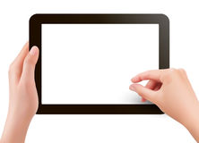 Fingers pinching to zoom tablet s screen Stock Images