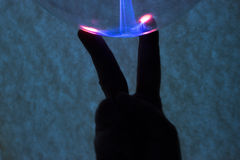 Fingers and plasma Stock Images