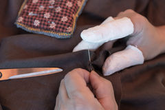 Fingers in plaster and needle pincushion royalty free stock images