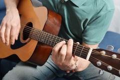 Fingers from playing acoustic guitar Stock Photography