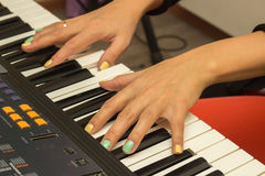 Fingers playing electronic piano keyboards Royalty Free Stock Photography
