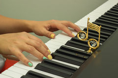 Fingers playing electronic piano keyboards Royalty Free Stock Photos