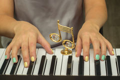 Fingers playing electronic piano keyboards Stock Image