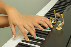 Fingers playing electronic piano keyboards Royalty Free Stock Photo