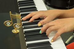Fingers playing electronic piano keyboards Royalty Free Stock Image