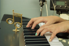 Fingers playing electronic piano keyboards Royalty Free Stock Images