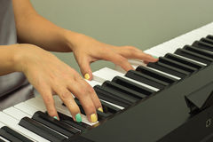Fingers playing electronic piano keyboards Stock Photography