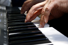 Fingers playing piano Stock Photos
