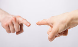 Fingers poiniting at each other Stock Photo