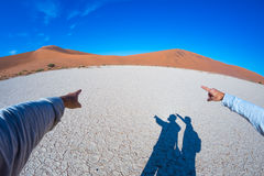 Fingers pointing to the scenic sand dunes of Sossusvlei, Namib Naukluft National Park, Namibia, Africa. Adventure and exploration. In Africa, concept of people Royalty Free Stock Photo