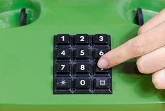 Fingers press dial buttons on old retro telephone Royalty Free Stock Photos