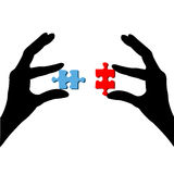 Fingers and puzzle Stock Image