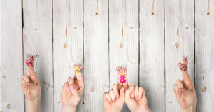 Fingers with rabbits with wood background. happy Easter. Royalty Free Stock Photo
