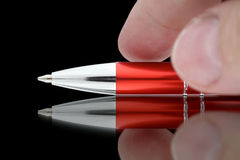 Fingers reaching for ball pen. stock images