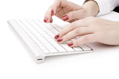 Fingers with red nail. Typing on keyboard Stock Photography