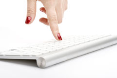 Fingers with red nail. Touching keyboard Stock Images