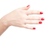 Fingers with red nails on white Stock Photo
