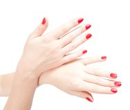Fingers with red nails on white. Woman hands with red nails. Isolated on white Royalty Free Stock Photography