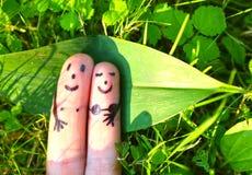Fingers represent loving couple sunbathing Royalty Free Stock Photography