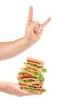 Fingers rock with big sandwich Royalty Free Stock Photography