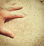 Fingers sand. Introducing my fingers into the sand Royalty Free Stock Photography
