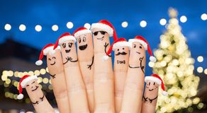 Fingers in santa hats over night lights background Royalty Free Stock Photos