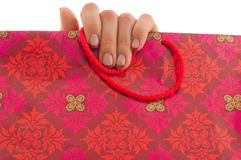 Fingers on shopping bag Royalty Free Stock Photography