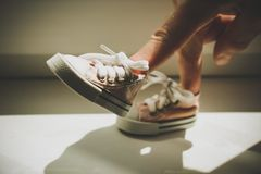 Fingers in the sneakers. Royalty Free Stock Photo