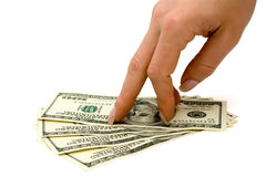 Fingers stepping on money Stock Images