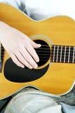 Fingers Strum Acoustic Guitar Stock Photo
